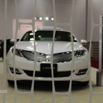 On the floor of the Dallas Auto Show, we're checking out the 2014 Lincoln MKZ feeling a bit caged.