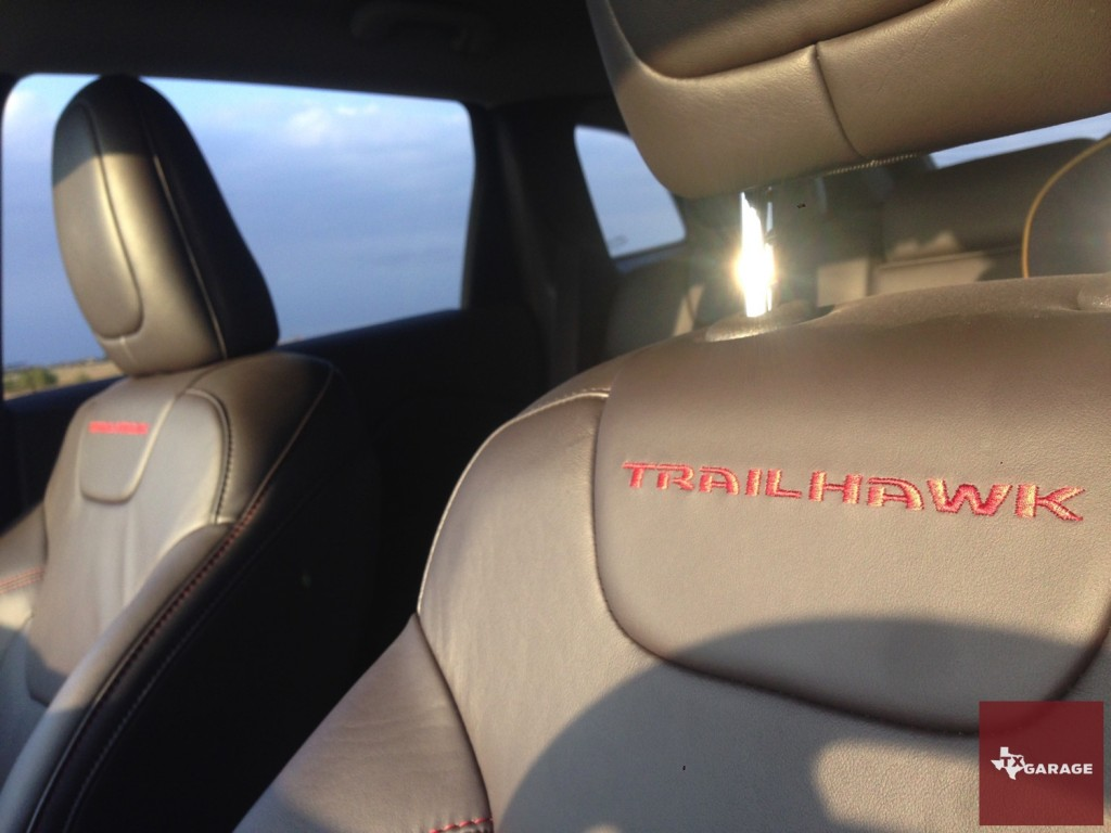 Trailhawk sporting black-leather seats with read stitching.