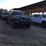 Trucks staged and ready to go at Rio Bravo Motocross Park.