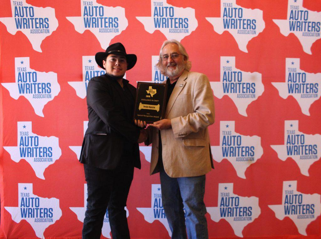 Jesus Garcia receiving his award